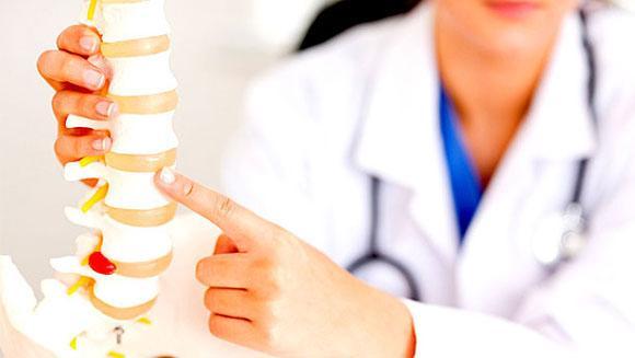 Чому болить спина